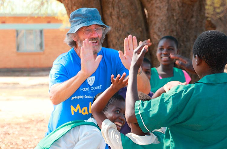 Teaching Malawi children how to high five