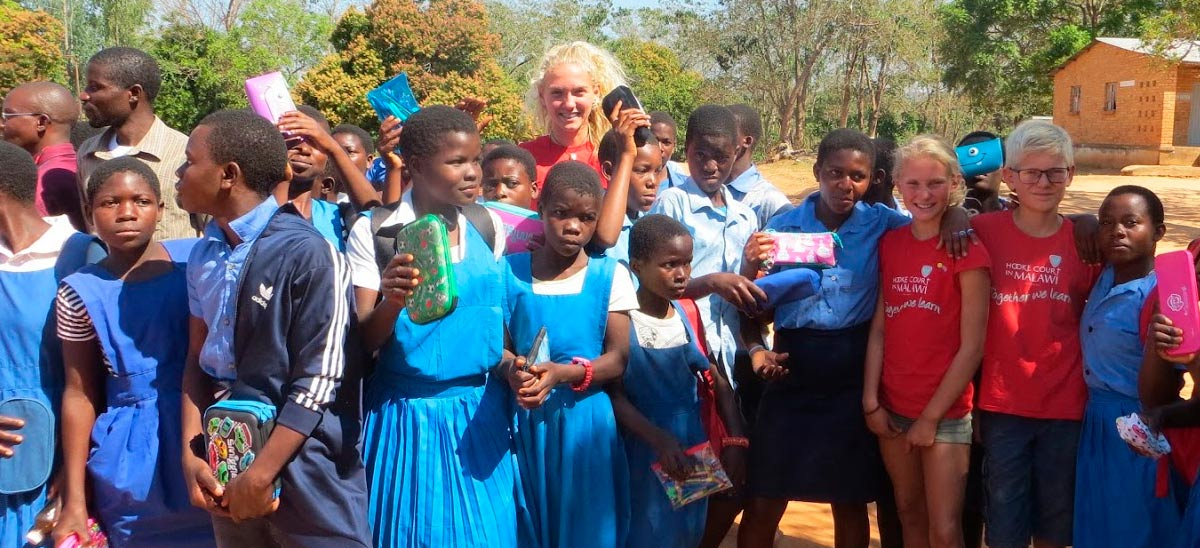 A happy volunteer enjoying her time with the local school children